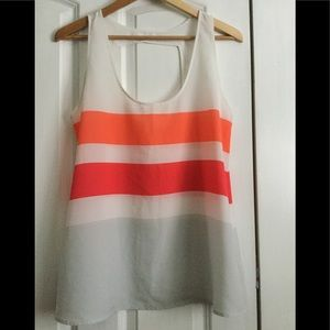 Vibrant colored tank with cutout detail